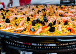 Seafood paella in a paella pan at a street food market